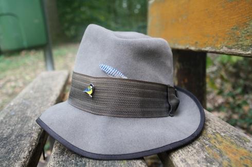 op je hoed